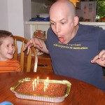 Robbie prepares to blow out his candles